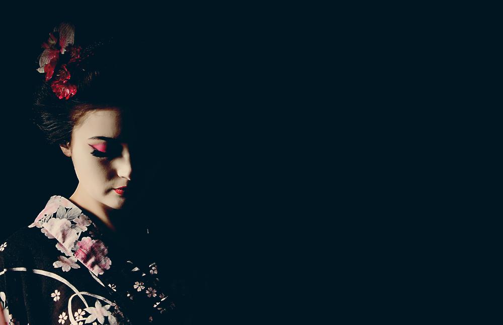woman styled as a geisha