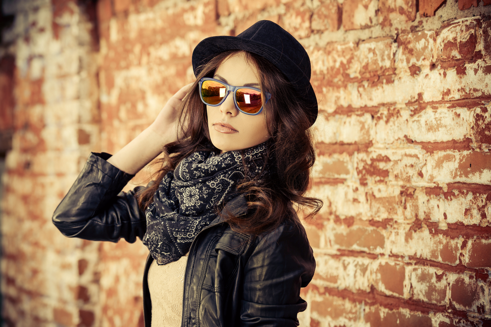 woman with leather jacket, hat and scarf