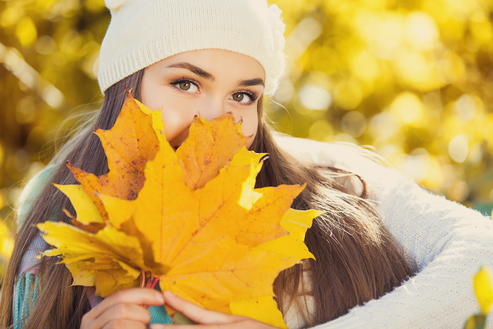 woman with fall leaves