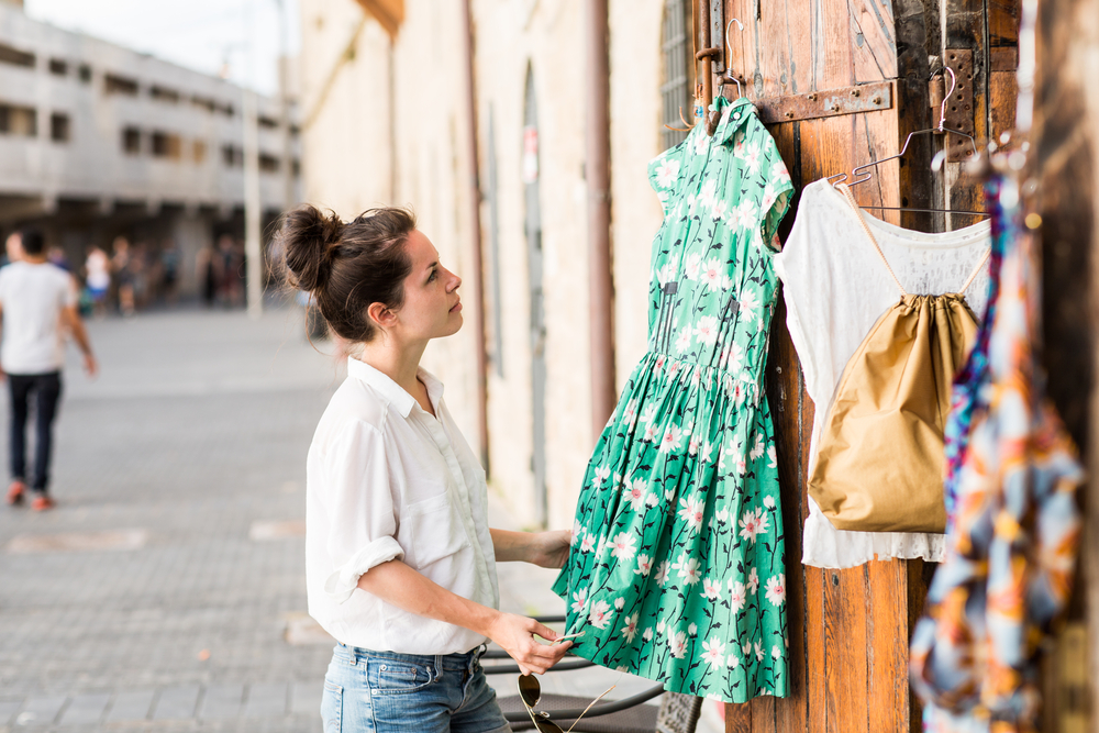 woman looking at vintage dress